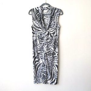 Abria Comfortable Animal Print Twist Front Dress